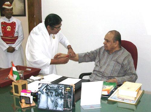 BK Aruna Behn OF Pune Is Tying Rakhi To Governor Of Maharashtra .H. E. K.Shankarnarayanan Ji
