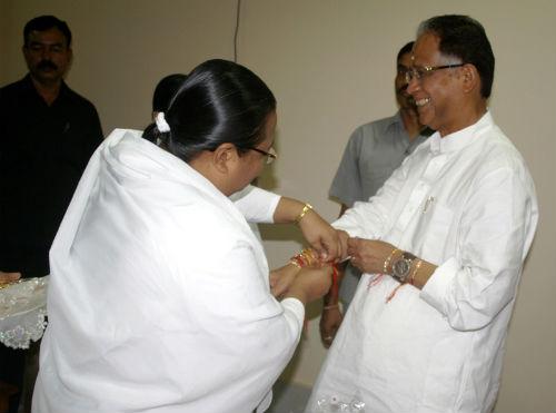 Tying Rakhi to Assam's Chief Minister Tarun Gogoi