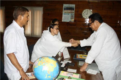 Tying Rakhi to Assam's Minister