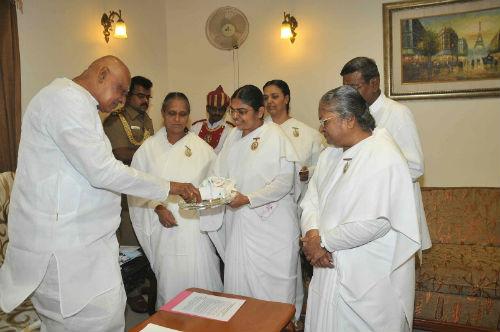 Tying Rakhi to Chennai Governor Dr. K. Rosaiah