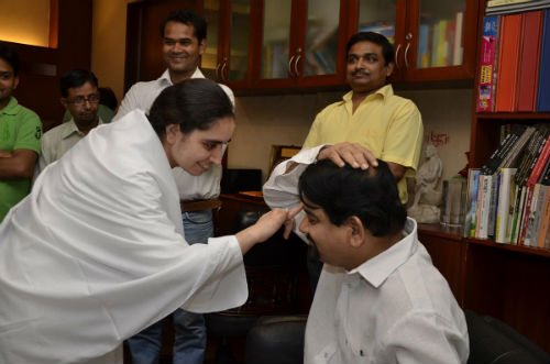 Brahmakumaris Tying Rakhi to Media Professionals in Delhi