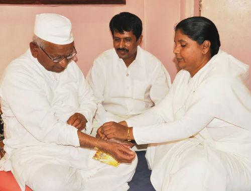 Governor of Maharastra HE Shankaraarayanan & Social Activist Anna Hajare being tied Rakhi by BK Sisters