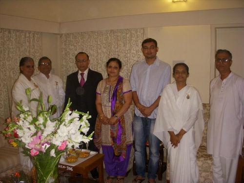 Sis. BK Jyothi Tying  Rakhi to  Honb'le Chief Justice of Karnataka High Court - Mr. D.H. Waghela & Family